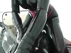 Two People in Latex Catsuits have oral sex