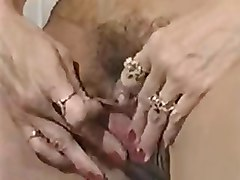 MILF plays with her big clit