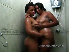 Hot booty African lesbians spread soap on each other
