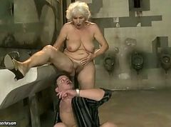 Lusty granny gets fucked hard in public toilet