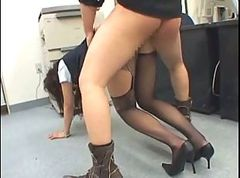 Jap girl fucks in the office with head in the photocopier