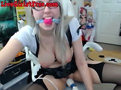 this busty camgirl loves masturbating with a ball gag in her mouth