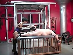 Punishing mistress uses a leather strap