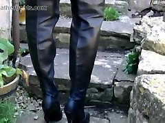 kinky blonde smoking in leather boots and giving up skirt close ups of her sexy pussy