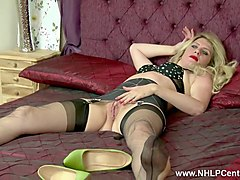 blonde milf slut teasing and playing with pussy in the bedroom in retro lingerie nylons and heels