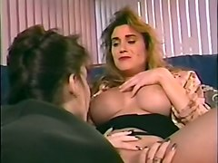 blonde busty milf lady seduced by brunette girl on the couch