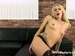 hot blonde pees in front of the camera after playing with her sweet pussy